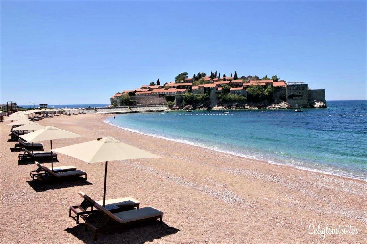 Sveti Stefan, Montenegro | Stupid Pretty Towns in Europe | Best Towns in the Balkans | Balkan Cities to Visit | Best European Villages to Visit | Small Towns in Europe | Picturesque European Town | Best Towns to Visit in Montenegro | Pretty Montenegrin Towns | Fairy Tale Towns in Europe | European Fairy Tale Villages | Best Old Towns in Europe | #SvetiStefan #Montenegro #Europe - California Globetrotter